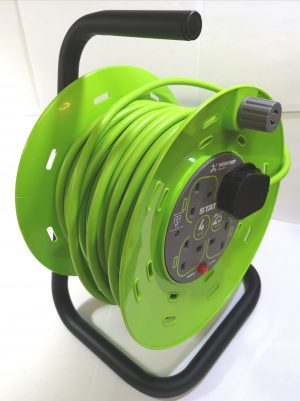 A sturdy 25 meter extension reel with thermal cut-out, black metal stand & handle and green cassette holder for the cable.
