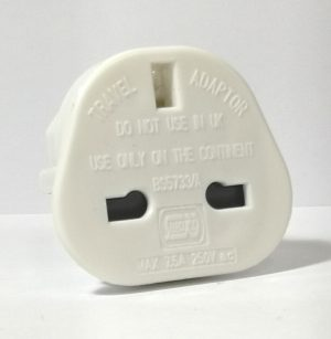 A white plastic UK to European travel adaptor for your small appliances